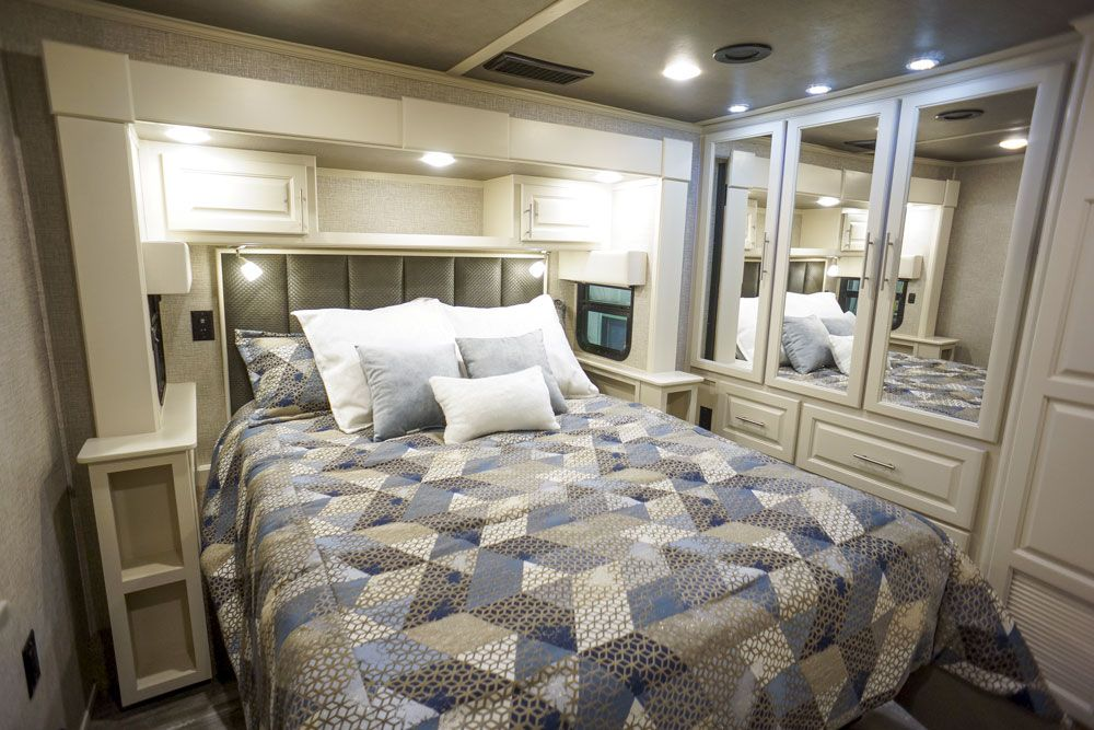 Luxury toy hauler queen bedroom