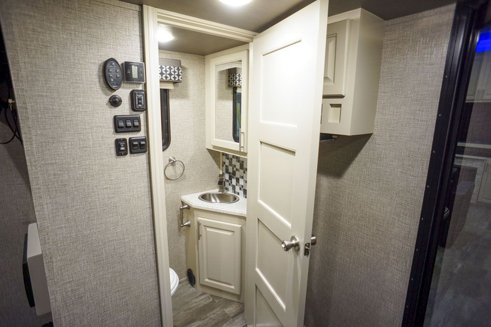 Luxury toy hauler garage half bath01