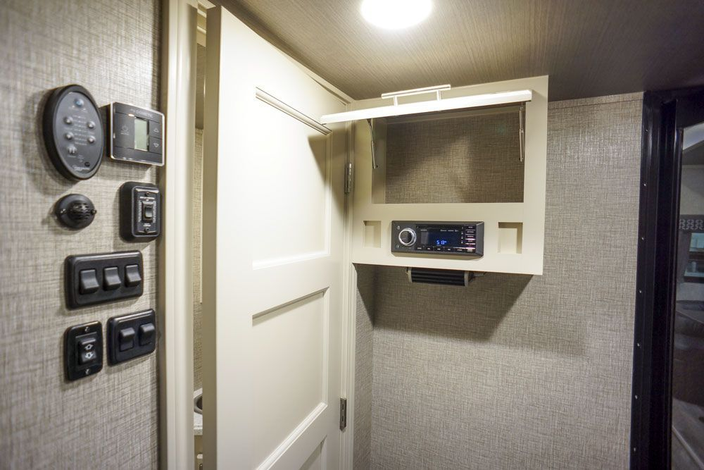 Luxury toy hauler garage half bath window